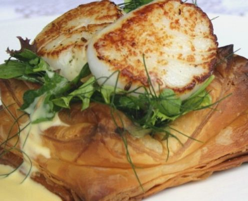 Scallop poached cod champagne sauce