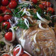 Whole fish baked tomato olives