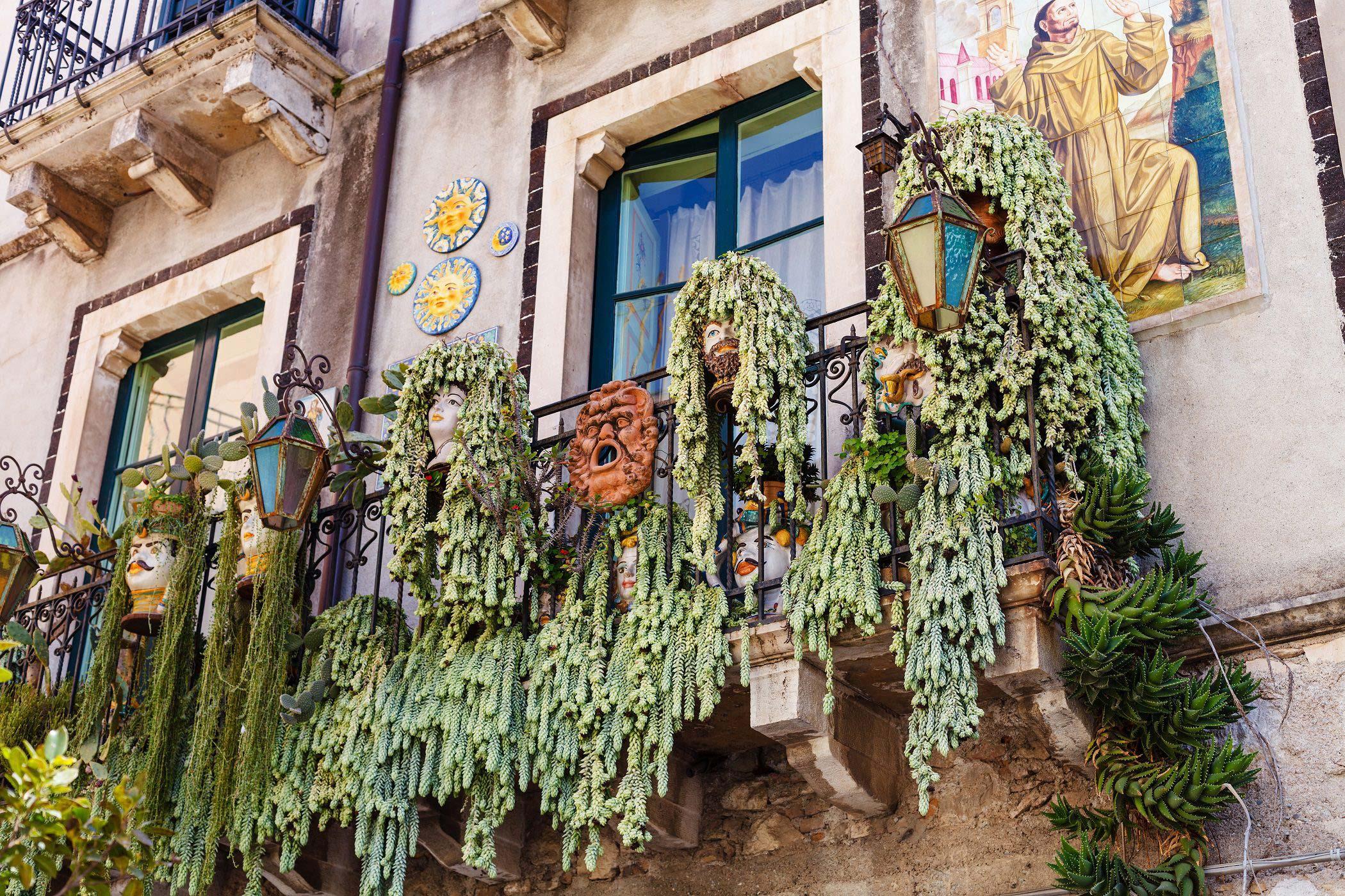 TAORMINA, ITALY - APRIL 3, 2015: traditional decoration on balcony of urban house in Taormina town, Sicily.
